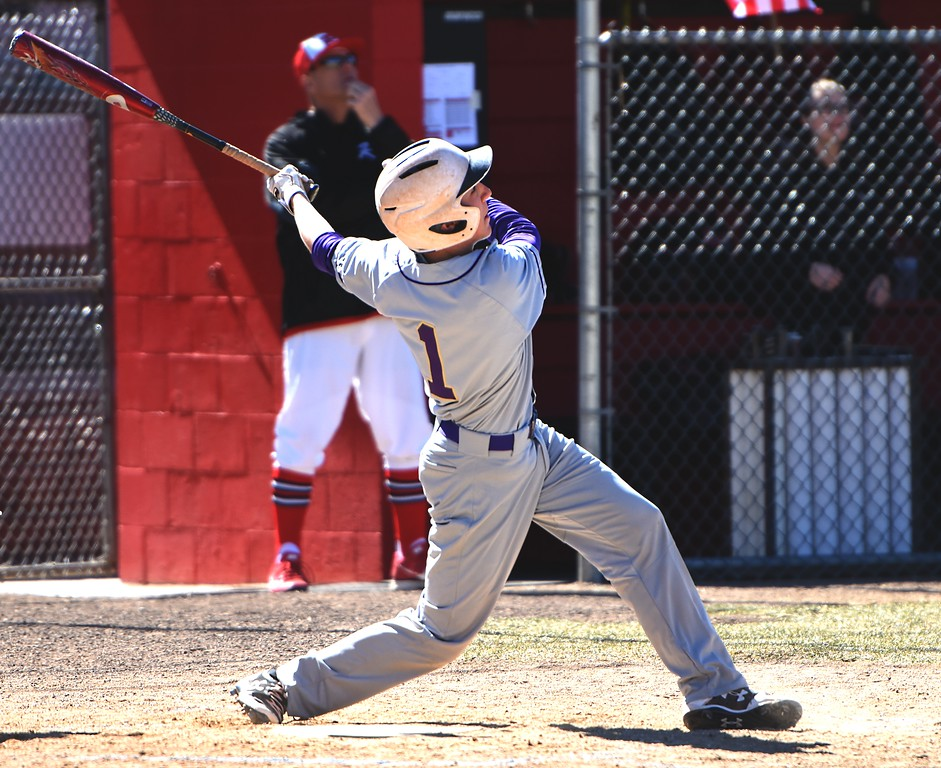 Boulder's Tommy Wymore watches a long fly ball off his bat against Rangeview on Saturday, March 17, in Aurora.