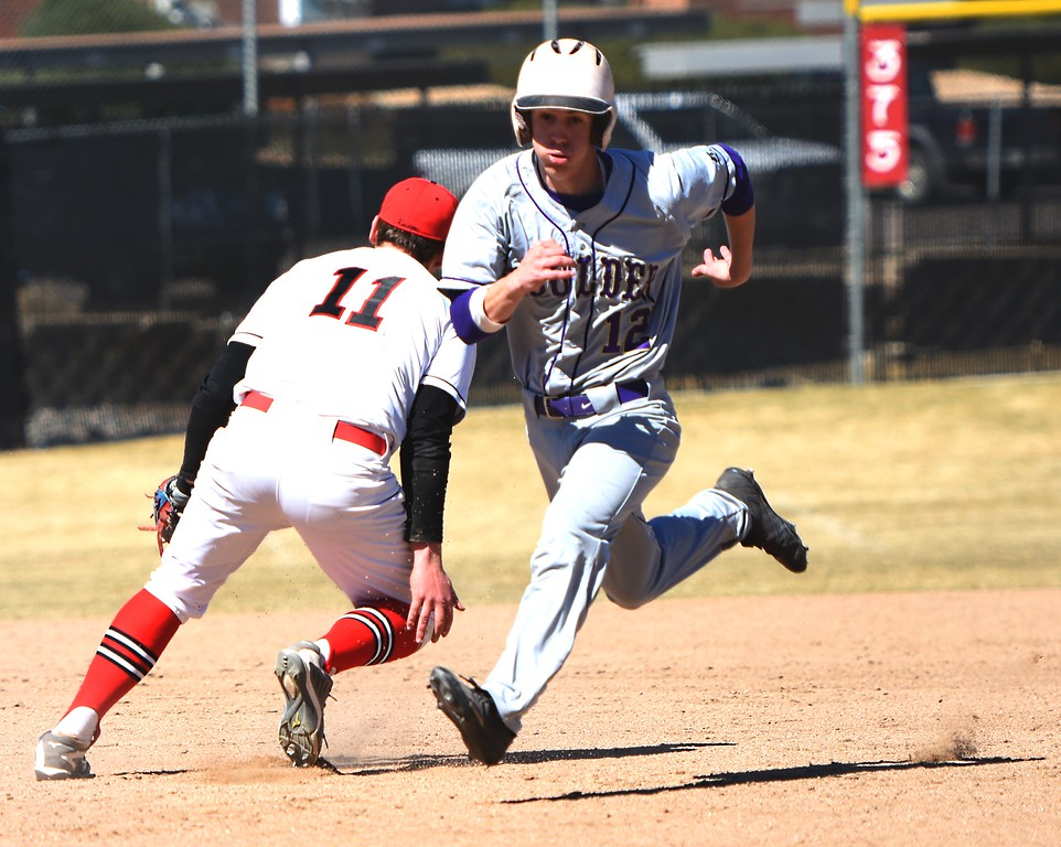 Boulder's Kyle Harris prepares to make the turn at third base and head for home against Rangeview on Saturday, March 17, in Aurora.