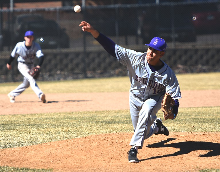 Boulder's Sanjay Solomon delivers a pitch against Rangeview on Saturday, March 17, in Aurora.