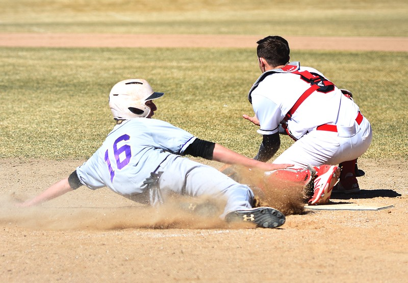 Boulder's Sean Coan just beats a throw as he slides into home plate during the fifth inning against Rangeview on Saturday, March 17, in Aurora.