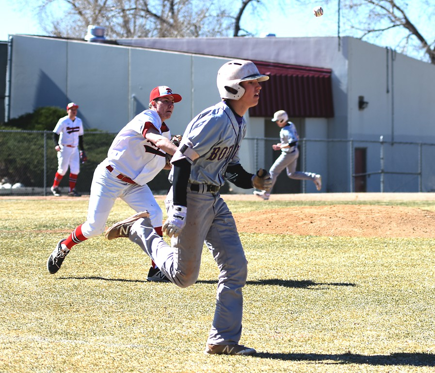 Boulder's Johnny Suchor attempts to beat out a sacrifice bunt while a teammate advances to third against Rangeview on Saturday, March 17, in Aurora.