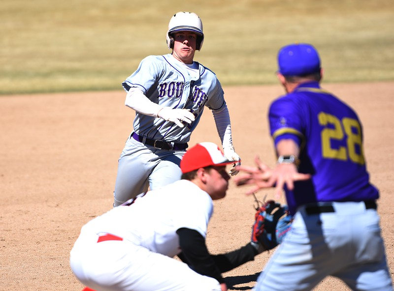 Boulder's Ethan Prout attempts to slide around a tag as directed by coach Jack Taylor during the Panthers' win over Rangeview on Saturday, March 17, in Aurora.