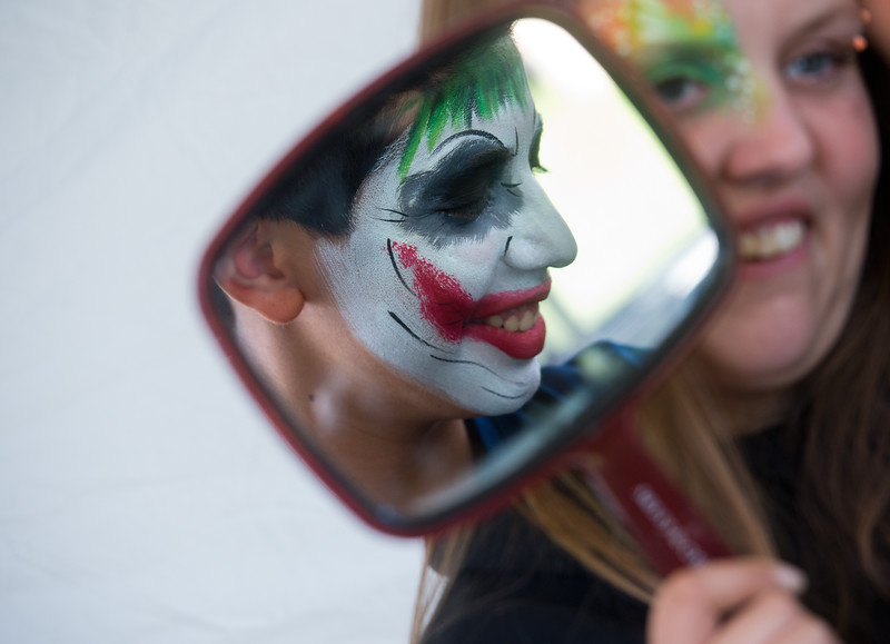 "Ariella Chipps, with Face to Face,  shows Gustavo Morales, 12, his face painting at the Hometown Fair in Boulder's Central Park on Saturday.<br /> More photos:  <a href=""http://www.dailycamera.com"">http://www.dailycamera.com</a><br /> (Autumn Parry/Staff Photographer)<br /> September 3, 2016"