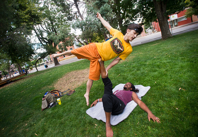 "Matt Moore balances on Nosa Edebor as they practice AcroYoga at the Hometown Fair in Boulder's Central Park on Saturday. <br /> More photos:  <a href=""http://www.dailycamera.com"">http://www.dailycamera.com</a><br /> (Autumn Parry/Staff Photographer)<br /> September 3, 2016"