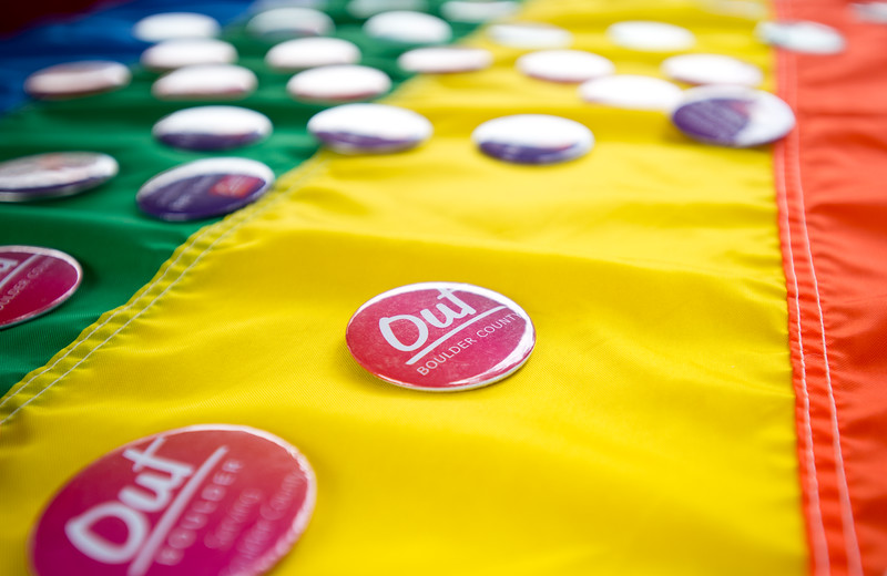 """Out Boulder County gives away pins during Pridefest at Central Park in Boulder on Sunday. <br /> More photos:  <a href=""""http://www.dailycamera.com"""">http://www.dailycamera.com</a><br /> (Autumn Parry/Staff Photographer)<br /> September 11, 2016"""