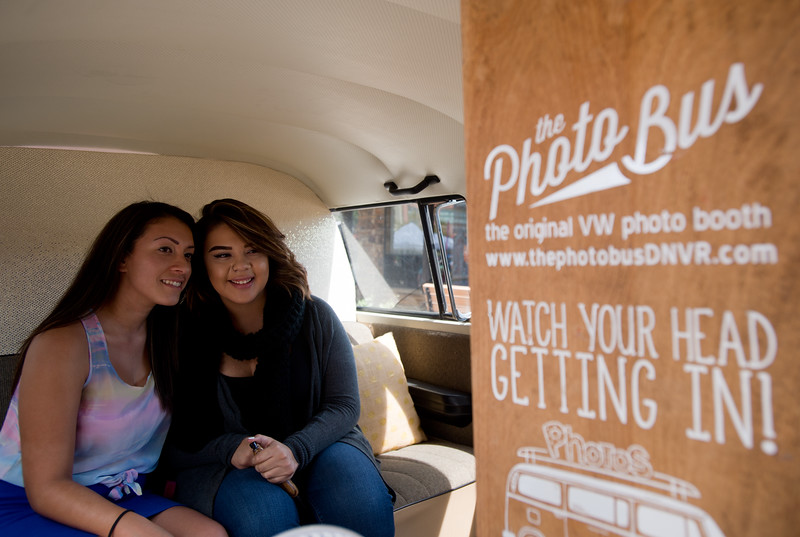 """Alexis Covarrubias (right) and her girlfriend Amairani Alamillo take photos of themselves in The Photo Bus during Pridefest at Central Park in Boulder on Sunday.<br /> More photos:  <a href=""""http://www.dailycamera.com"""">http://www.dailycamera.com</a><br /> (Autumn Parry/Staff Photographer)<br /> September 11, 2016"""