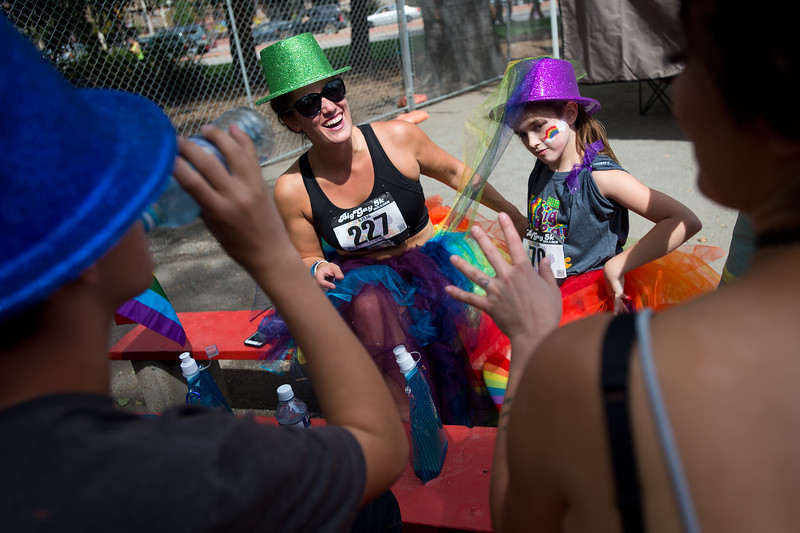 "Lyndall Ellingson (left) and Ava Abbey, 10, talk with friends and family while listening to performances at the Central Park Bandshell during Pridefest in Boulder on Sunday. <br /> More photos:  <a href=""http://www.dailycamera.com"">http://www.dailycamera.com</a><br /> (Autumn Parry/Staff Photographer)<br /> September 11, 2016"