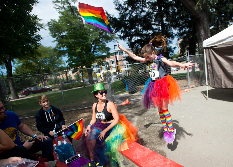 "Ava Abbey, 10, jumps off a bleacher while spending time with family and friends during Pridefest at Central Park in Boulder on Sunday.<br /> More photos:  <a href=""http://www.dailycamera.com"">http://www.dailycamera.com</a><br /> (Autumn Parry/Staff Photographer)<br /> September 11, 2016"
