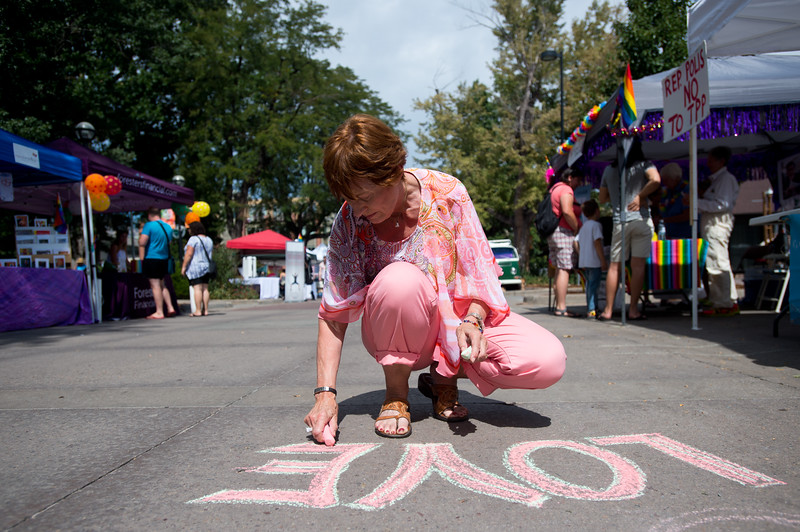 """Bev Coogan writes with chalk during the Pridefest at Central Park in Boulder on Sunday. <br /> More photos:  <a href=""""http://www.dailycamera.com"""">http://www.dailycamera.com</a><br /> (Autumn Parry/Staff Photographer)<br /> September 11, 2016"""