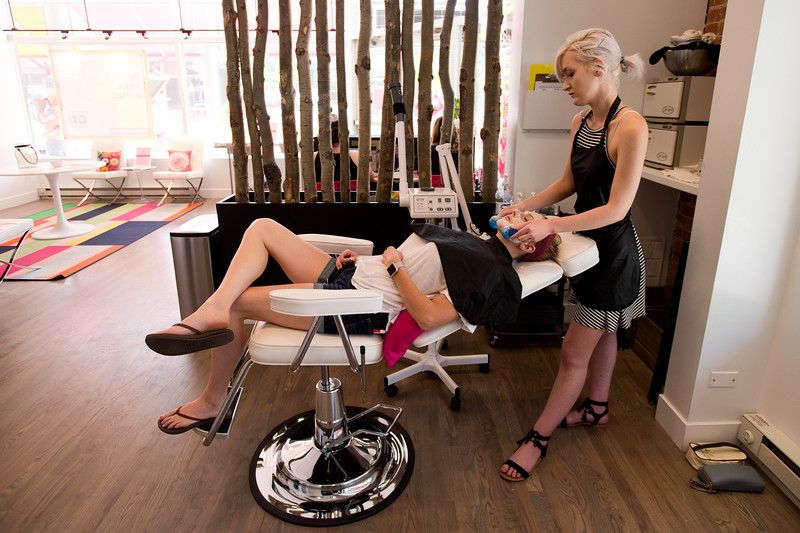 """Nadja Heath, an esthetician, gives Courtney Robinson a breast milk facial using magic globes to massage her skin at Mud Facial Bar in Boulder on Thursday. <br /> More photos:  <a href=""""http://www.dailycamera.com"""">http://www.dailycamera.com</a><br /> (Autumn Parry/Staff Photographer)<br /> July 7, 2016"""