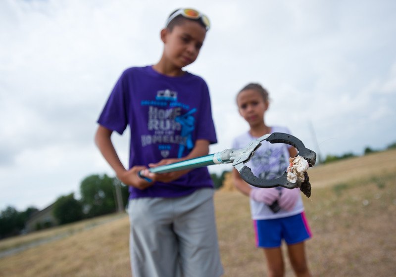 "Shawn Ryan, 12, and his sister Brielle Ryan, 7, examine a piece of trash they found near the Le Gault Reservoir during Broomfield's first Volunteer Week, which began with a community cleanup on Saturday. <br /> More photos:  <a href=""http://www.dailycamera.com"">http://www.dailycamera.com</a><br /> (Autumn Parry/Staff Photographer)<br /> August 6, 2016"