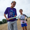 """Shawn Ryan, 12, and his sister Brielle Ryan, 7, examine a piece of trash they found near the Le Gault Reservoir during Broomfield's first Volunteer Week, which began with a community cleanup on Saturday. <br /> More photos:  <a href=""""http://www.dailycamera.com"""">http://www.dailycamera.com</a><br /> (Autumn Parry/Staff Photographer)<br /> August 6, 2016"""