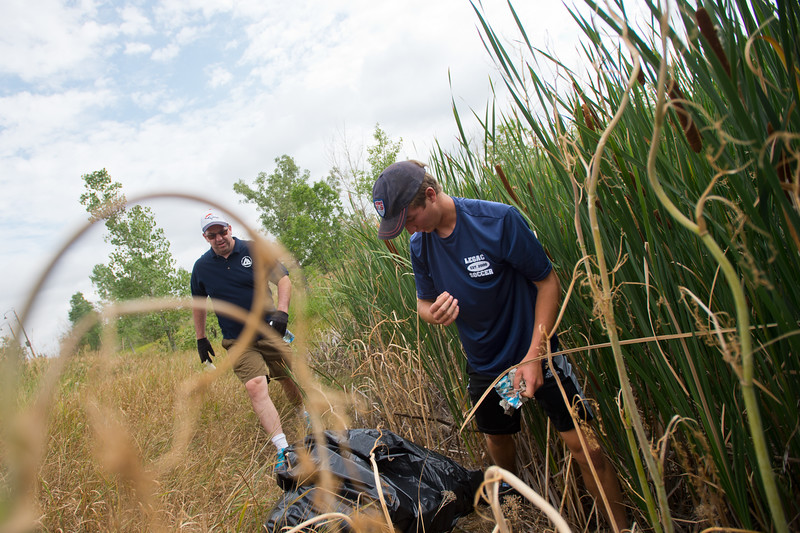 "Jim Becklenberg, left, and Dylan Nun pick up trash near Le Gault Reservoir during a community cleanup as part of Volunteer Week, in Broomfield on Saturday. <br /> More photos:  <a href=""http://www.dailycamera.com"">http://www.dailycamera.com</a><br /> (Autumn Parry/Staff Photographer)<br /> August 6, 2016"