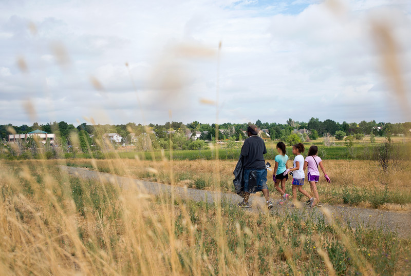 "Shawn Ryan (left) walks with his daughter Brielle Ryan, 7, and her friends Gianna Partida, 7, and Corina Ledbetter, 7, as they look for trash near Le Gault Reservoir during a community cleanup as part of Volunteer Week, in Broomfield on Saturday. <br /> More photos:  <a href=""http://www.dailycamera.com"">http://www.dailycamera.com</a><br /> (Autumn Parry/Staff Photographer)<br /> August 6, 2016"