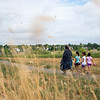 """Shawn Ryan (left) walks with his daughter Brielle Ryan, 7, and her friends Gianna Partida, 7, and Corina Ledbetter, 7, as they look for trash near Le Gault Reservoir during a community cleanup as part of Volunteer Week, in Broomfield on Saturday. <br /> More photos:  <a href=""""http://www.dailycamera.com"""">http://www.dailycamera.com</a><br /> (Autumn Parry/Staff Photographer)<br /> August 6, 2016"""