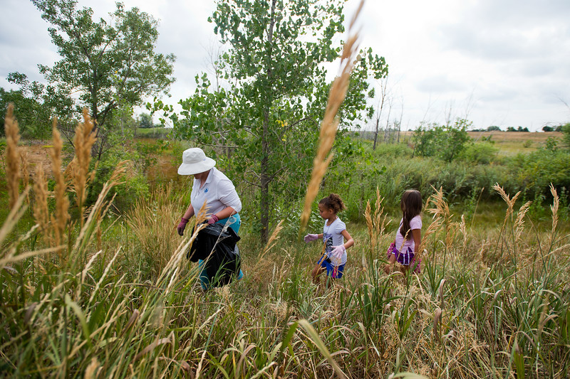 "From left to right, Elizabeth Law-Evans, Brielle Ryan, 7, and her friend Corina Ledbetter, 7, search near Le Gault Reservoir for trash during a community cleanup, as part of Volunteer Week, in Broomfield on Saturday. <br /> More photos:  <a href=""http://www.dailycamera.com"">http://www.dailycamera.com</a><br /> (Autumn Parry/Staff Photographer)<br /> August 6, 2016"