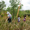 """From left to right, Elizabeth Law-Evans, Brielle Ryan, 7, and her friend Corina Ledbetter, 7, search near Le Gault Reservoir for trash during a community cleanup, as part of Volunteer Week, in Broomfield on Saturday. <br /> More photos:  <a href=""""http://www.dailycamera.com"""">http://www.dailycamera.com</a><br /> (Autumn Parry/Staff Photographer)<br /> August 6, 2016"""