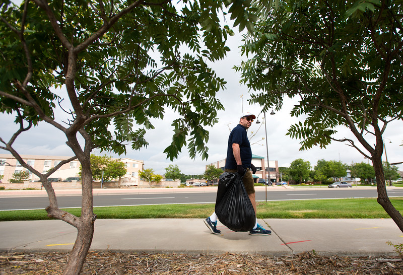 "Jim Becklenberg looks for trash along Sheridan Boulevard during a community cleanup, as part of Volunteer Week, in Broomfield on Saturday. <br /> More photos:  <a href=""http://www.dailycamera.com"">http://www.dailycamera.com</a><br /> (Autumn Parry/Staff Photographer)<br /> August 6, 2016"