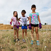 """From left to right, Corina Ledbetter, 7, Brielle Ryan, 7, and Gianna Partida, 7, search for trash during a community cleanup, as part of Volunteer Week, in Broomfield on Saturday.  <br /> More photos:  <a href=""""http://www.dailycamera.com"""">http://www.dailycamera.com</a><br /> (Autumn Parry/Staff Photographer)<br /> August 6, 2016"""
