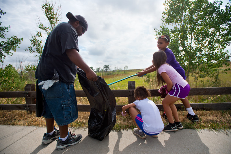 "From left to right, Shawn Ryan, holds out a bag as his daughter Brielle Ryan, 7, her friend Corina Ledbetter, 7, and Shawn Ryan Jr., 12, collect trash near Le Gault Reservoir during a community cleanup as part of Volunteer Week, in Broomfield on Saturday. <br /> More photos:  <a href=""http://www.dailycamera.com"">http://www.dailycamera.com</a><br /> (Autumn Parry/Staff Photographer)<br /> August 6, 2016"