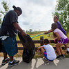 """From left to right, Shawn Ryan, holds out a bag as his daughter Brielle Ryan, 7, her friend Corina Ledbetter, 7, and Shawn Ryan Jr., 12, collect trash near Le Gault Reservoir during a community cleanup as part of Volunteer Week, in Broomfield on Saturday. <br /> More photos:  <a href=""""http://www.dailycamera.com"""">http://www.dailycamera.com</a><br /> (Autumn Parry/Staff Photographer)<br /> August 6, 2016"""