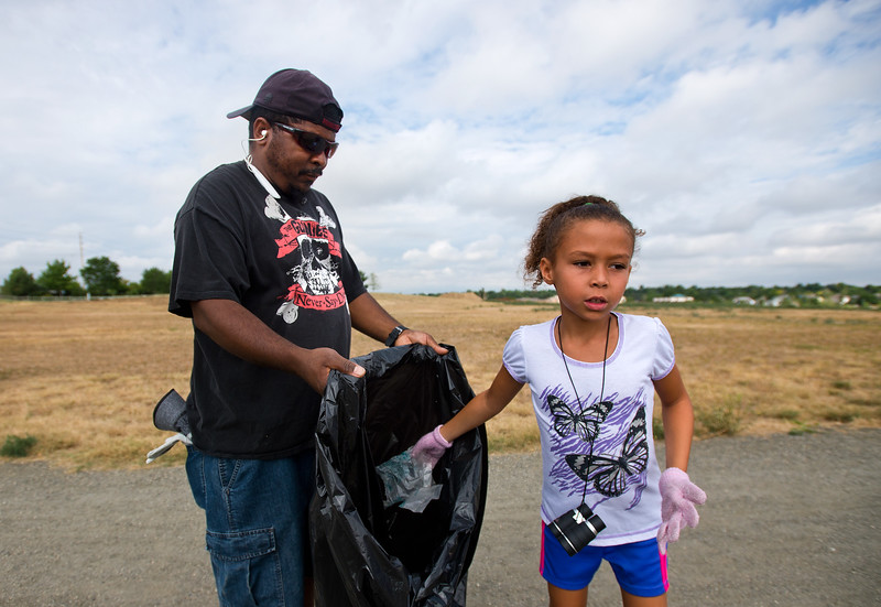 "Brielle Ryan, 7, discards trash as she participates in the community cleanup with her dad, Shawn Ryan, near Le Gault Reservoir in Broomfield on Saturday.  <br /> More photos:  <a href=""http://www.dailycamera.com"">http://www.dailycamera.com</a><br /> (Autumn Parry/Staff Photographer)<br /> August 6, 2016"