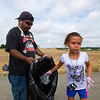 """Brielle Ryan, 7, discards trash as she participates in the community cleanup with her dad, Shawn Ryan, near Le Gault Reservoir in Broomfield on Saturday.  <br /> More photos:  <a href=""""http://www.dailycamera.com"""">http://www.dailycamera.com</a><br /> (Autumn Parry/Staff Photographer)<br /> August 6, 2016"""