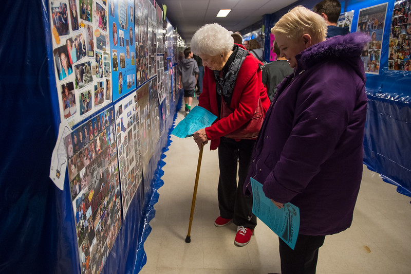 "Bernie Penrose, left, looks for photos of her two grandson's, who are both seniors, during JAM at Broomfield High School on Saturday.<br /> More photos:  <a href=""http://www.dailycamera.com"">http://www.dailycamera.com</a><br /> Autumn Parry/Staff Photographer<br /> April 30, 2016"