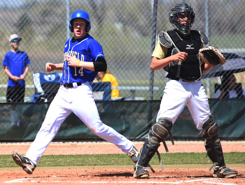 Broomfield's Hayden Van De Pol crosses home plate in the second inning during the baseball game between Broomfield and Legacy on Saturday, April 28, at Legacy High School in Broomfield.