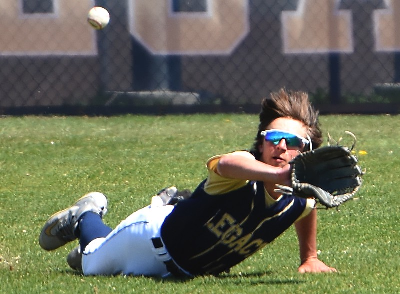 Legacy center fielder Chase Esplin makes a diving catch during the baseball game between Broomfield and Legacy on Saturday, April 28, at Legacy High School in Broomfield.