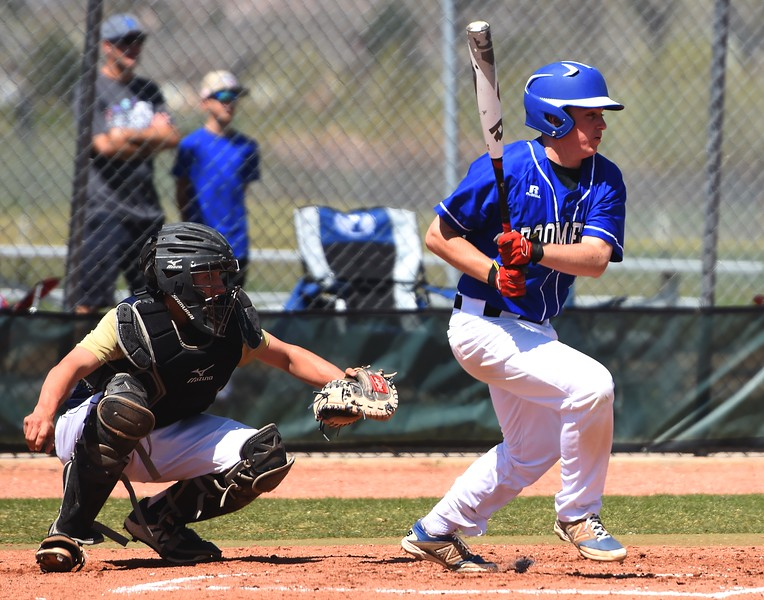 Broomfield's Zach Boh watches the ball off his bat during the baseball game between Broomfield and Legacy on Saturday, April 28, at Legacy High School in Broomfield.