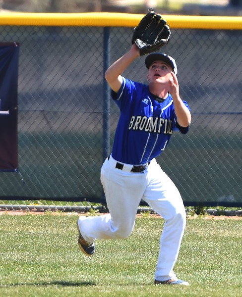 Broomfield right fielder Zach Boh shields his eyes from the sun to make a catch during the baseball game between Broomfield and Legacy on Saturday, April 28, at Legacy High School in Broomfield.