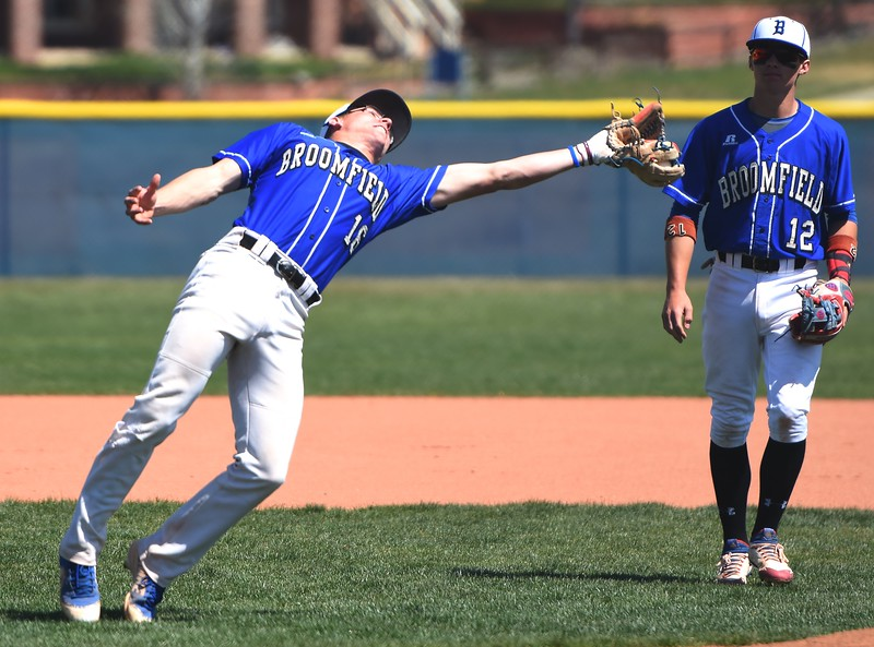 Broomfield third baseman Tanner Garner makes a last-second adjustment on a fly ball during the baseball game between Broomfield and Legacy on Saturday, April 28, at Legacy High School in Broomfield.