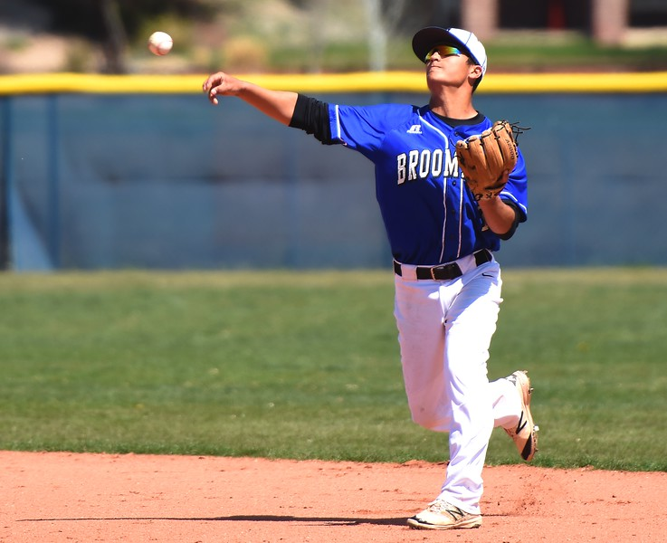 Broomfield second baseman Ryan Sena throws a runner out at first base during the baseball game between Broomfield and Legacy on Saturday, April 28, at Legacy High School in Broomfield.