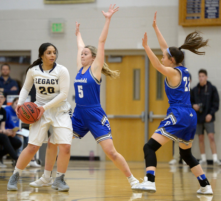 . BROOMFIELD, CO - FEBRUARY 5: Broomfield\'s Ellie Keeler, center, and Jessica Hoffman cover Legacy\'s Ariana Ahadi in the first quarter February 5, 2019 at Legacy High School. To view more photos visit bocopreps.com. (Photo by Lewis Geyer/Staff Photographer)