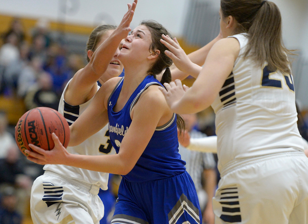 . BROOMFIELD, CO - FEBRUARY 5: Broomfield\'s Steph Peterson takes a shot between Legacy defenders in the second quarter February 5, 2019 at Legacy High School. To view more photos visit bocopreps.com. (Photo by Lewis Geyer/Staff Photographer)