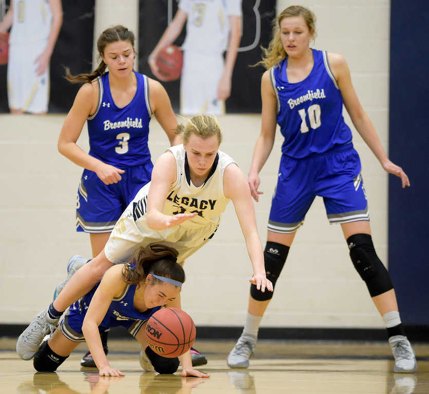 . BROOMFIELD, CO - FEBRUARY 5: Legacy\'s Halle Mackiewicz tumbles over Broomfield\'s Jessica Hoffman in the second quarter February 5, 2019 at Legacy High School. Broomfield\'s Steph Peterson, left, and Courtney Wristen defend from behind. To view more photos visit bocopreps.com. (Photo by Lewis Geyer/Staff Photographer)