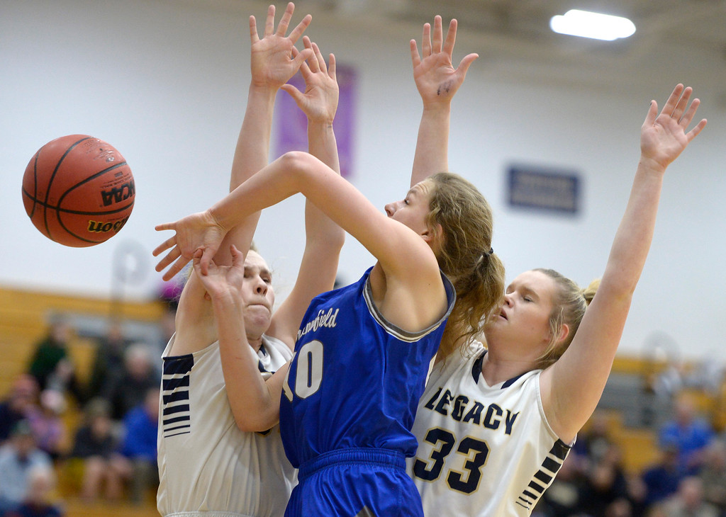 . BROOMFIELD, CO - FEBRUARY 5: Broomfield\'s Courtney Wristen loses the ball between Legacy\'s Halle Mackiewicz, left, and Brittany Baum in the first quarter February 5, 2019 at Legacy High School. To view more photos visit bocopreps.com. (Photo by Lewis Geyer/Staff Photographer)