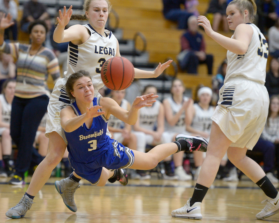 . BROOMFIELD, CO - FEBRUARY 5: Broomfield\'s Steph Peterson goes to the deck between Legacy\'s Halle Mackiewicz, left, and Brittany Baum in the first quarter February 5, 2019 at Legacy High School. To view more photos visit bocopreps.com. (Photo by Lewis Geyer/Staff Photographer)
