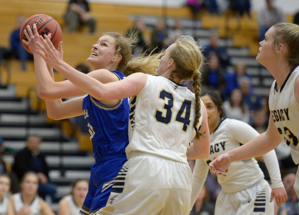 . BROOMFIELD, CO - FEBRUARY 5: Broomfield\'s Courtney Wristen takes a shot next to Legacy\'s Halle Mackiewicz in the first quarter February 5, 2019 at Legacy High School. To view more photos visit bocopreps.com. (Photo by Lewis Geyer/Staff Photographer)