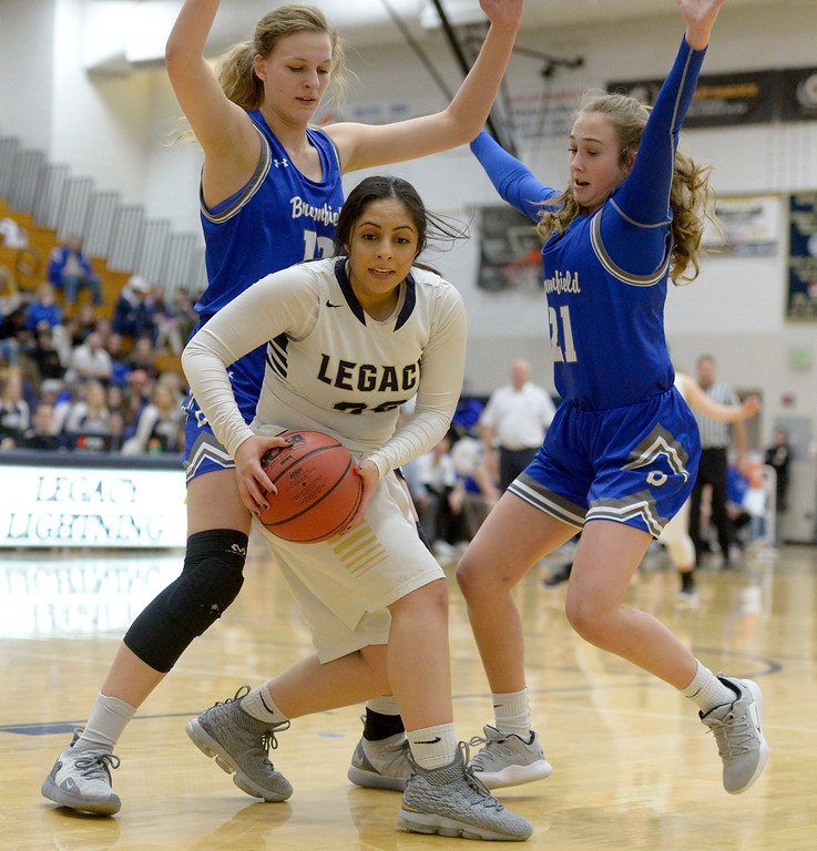 . BROOMFIELD, CO - FEBRUARY 5: Broomfield\'s Courtney Wristen, left, and Emma Rich cover Legacy\'s Ariana Ahadi in the second quarter February 5, 2019 at Legacy High School. To view more photos visit bocopreps.com. (Photo by Lewis Geyer/Staff Photographer)