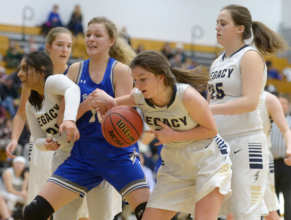 . BROOMFIELD, CO - FEBRUARY 5: Broomfield\'s Courtney Wristen has the ball stripped by Legacy\'s Emma Keaser in the second quarter February 5, 2019 at Legacy High School. Legacy\'s Ariana Ahadi, left, and Katie Paredes also defend. To view more photos visit bocopreps.com. (Photo by Lewis Geyer/Staff Photographer)