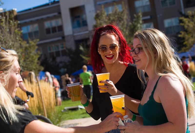 "Rachel Applehans (center) drinks with friends during Brewhaha, a block party with local breweries, food trucks and live bands, in Broomfield on Saturday. <br /> More photos:  <a href=""http://www.dailycamera.com"">http://www.dailycamera.com</a><br /> (Autumn Parry/Staff Photographer)<br /> October 15, 2016"