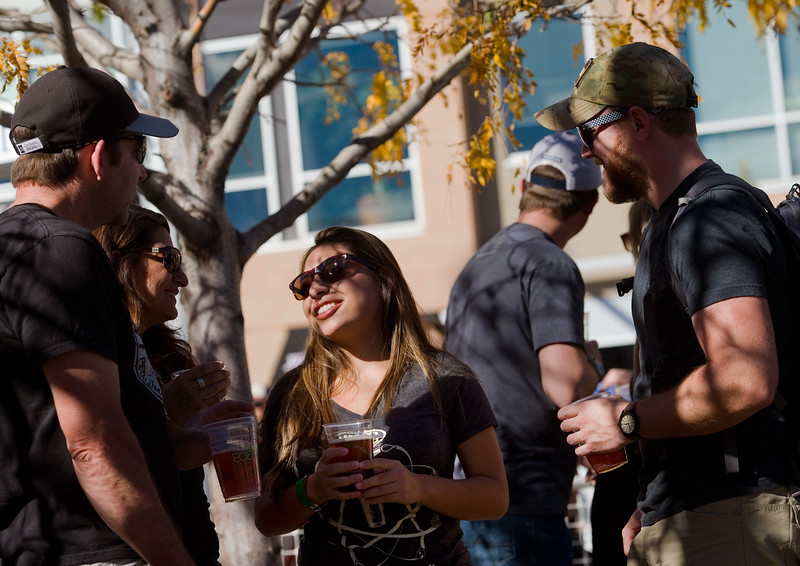 "From left to right, Mitch Stevens, Bern Lovato, Adrianne Lovato, and Kyser Baessler drink beer during Brewhaha, a block party with local breweries, food trucks and live bands, in Broomfield on Saturday. <br /> More photos:  <a href=""http://www.dailycamera.com"">http://www.dailycamera.com</a><br /> (Autumn Parry/Staff Photographer)<br /> October 15, 2016"