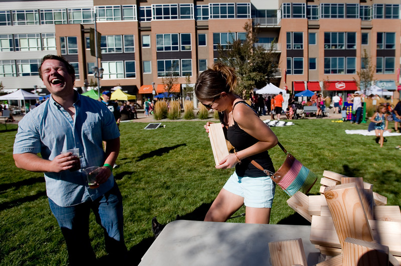 "Chris Aarvig laughs as Corinne Weinstein pulls the final piece out of a jenga tower, causing it to collapse, during Brewhaha, a block party with local breweries, food trucks and live bands, in Broomfield on Saturday. <br /> More photos:  <a href=""http://www.dailycamera.com"">http://www.dailycamera.com</a><br /> (Autumn Parry/Staff Photographer)<br /> October 15, 2016"