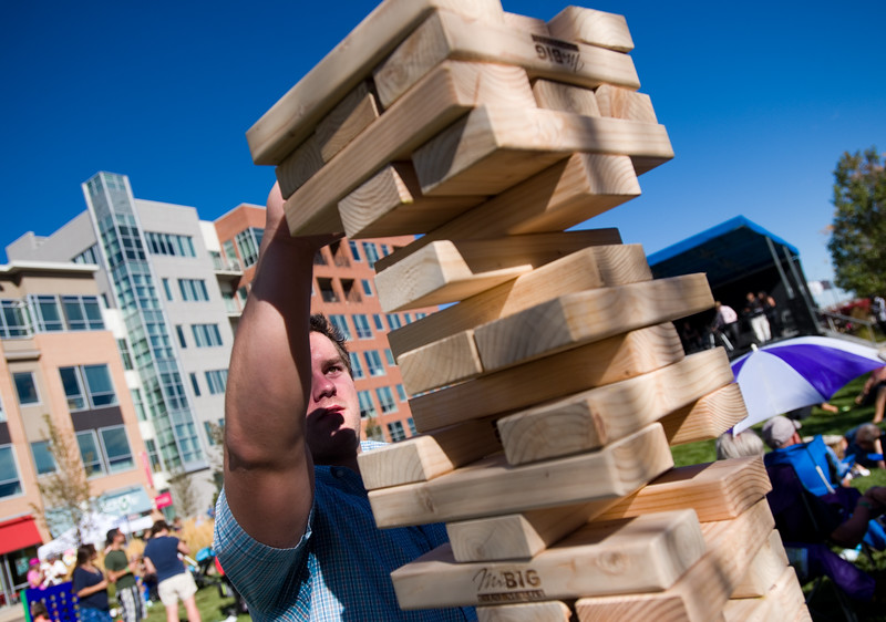 """Chris Aarvig plays jenga with friends during Brewhaha, a block party with local breweries, food trucks and live bands, in Broomfield on Saturday. <br /> More photos:  <a href=""""http://www.dailycamera.com"""">http://www.dailycamera.com</a><br /> (Autumn Parry/Staff Photographer)<br /> October 15, 2016"""