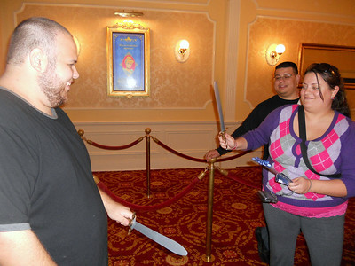 Sword fighting while waiting in line to meet the princesses.
