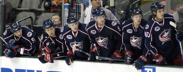Blue Jackets watching the game intently.