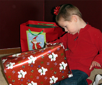 Nate starts to open his present from Chuck and I.