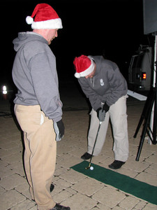 Scott and Troy playing golf.